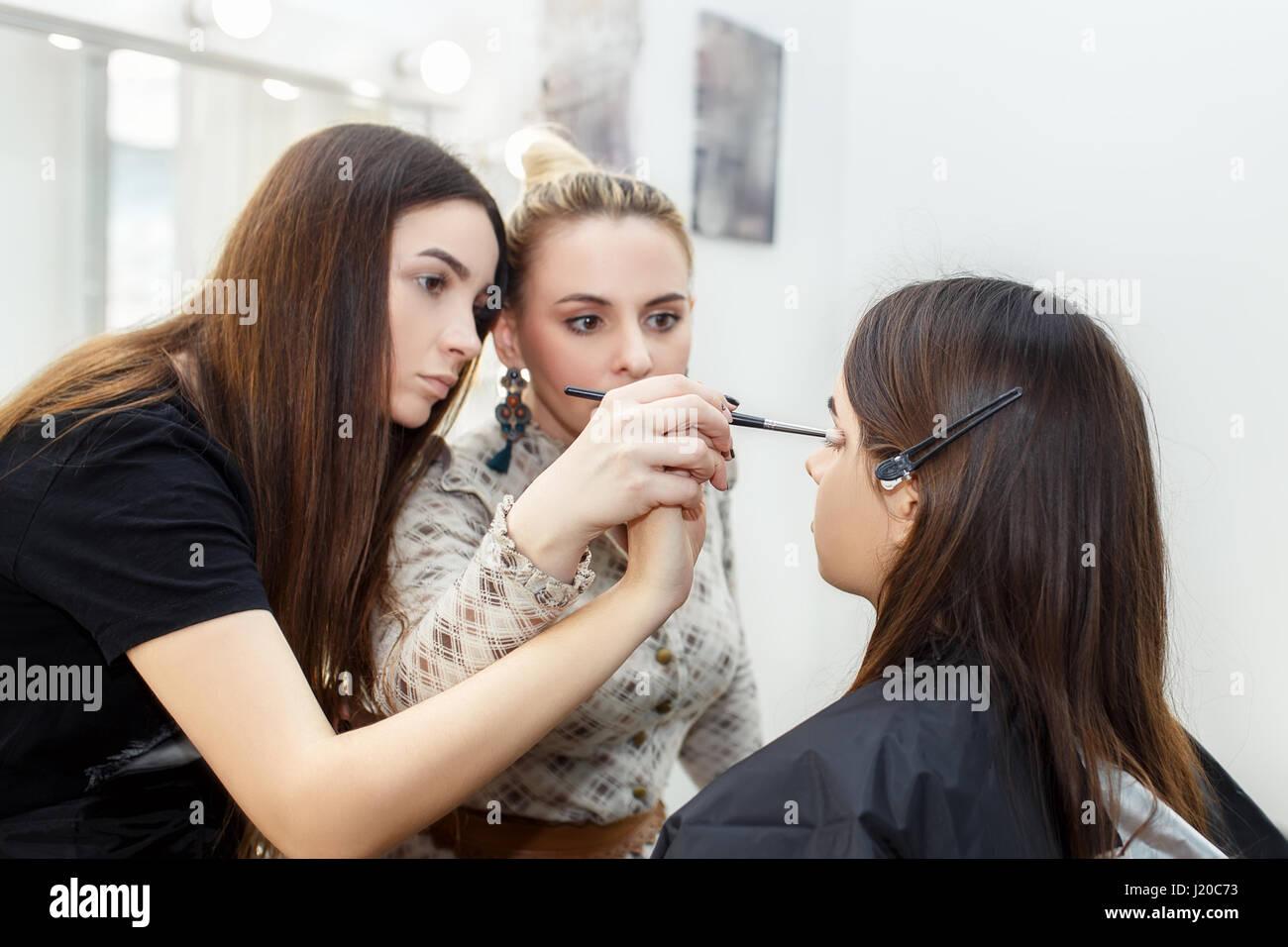 Makeup teacher with her student girl makeup tutorial lesson at makeup teacher with her student girl makeup tutorial lesson at beauty school make up artist work in her studio real people portrait of visagiste a baditri Images