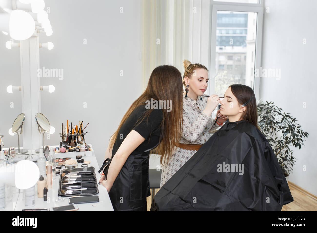 Makeup tutorial lesson at beauty school makeup teacher training makeup tutorial lesson at beauty school makeup teacher training her student girl to become makeup artist real people portrait of visagiste applying baditri Images