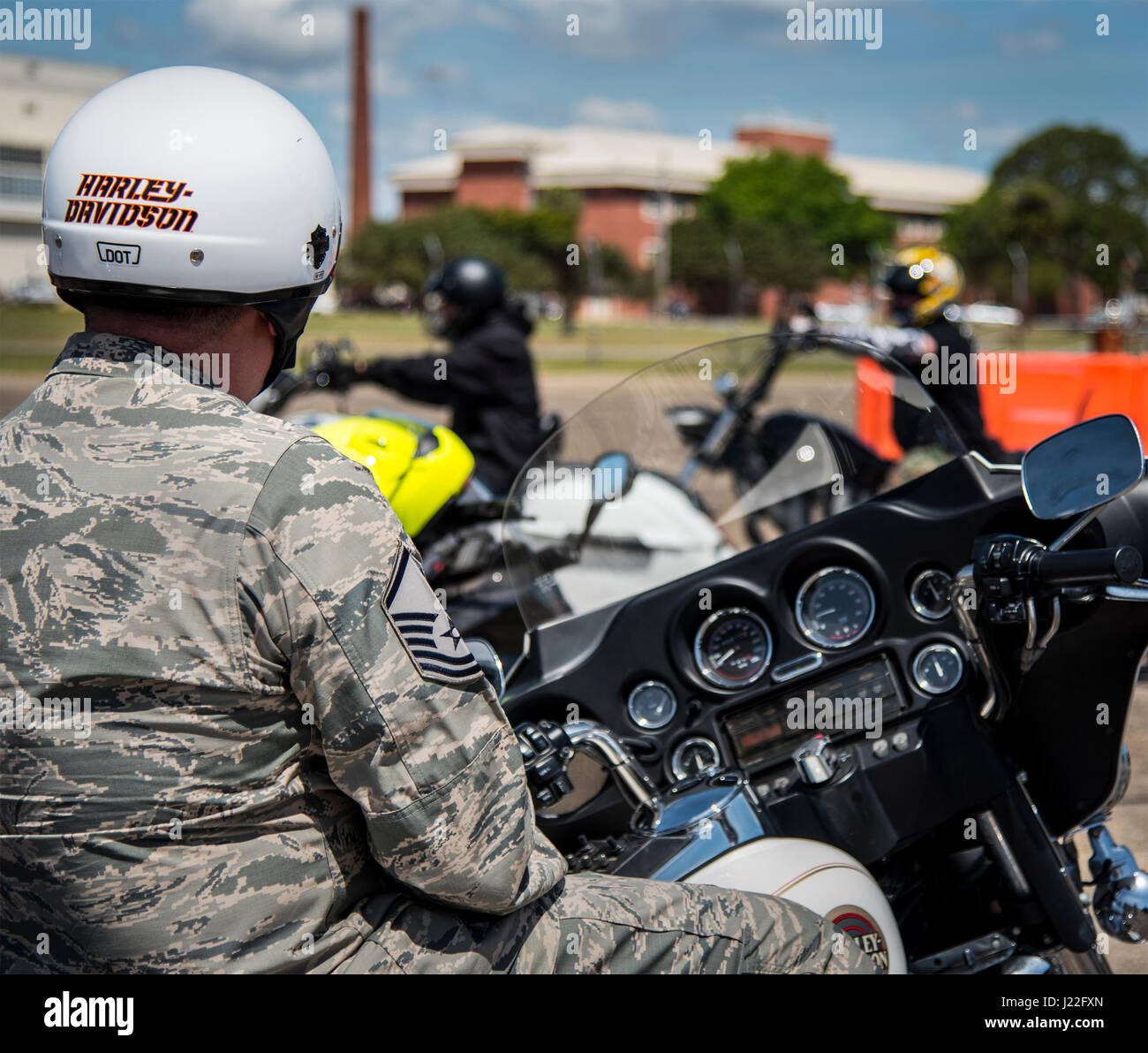 stock top wearing watches bikers the beach main down hat during motorcycles week biker bike daytona street march photo annual in of parade a