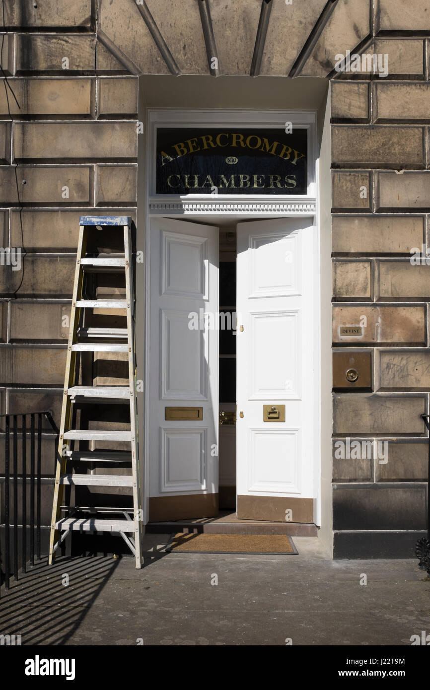 Exterior Wall Ladders : Ladder propped against an exterior wall beside the front
