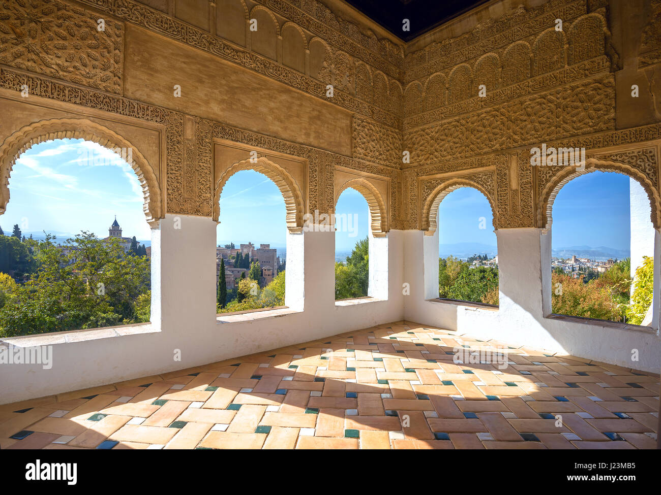 Interior decor of room with arches windows at Alhambra palace. Granada,  Andalusia, Spain