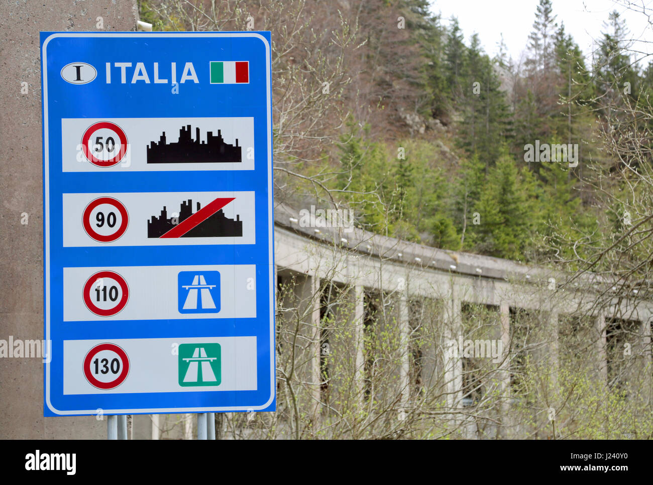 road sign at the italian border with indications of the speed limits stock photo 139000820 alamy. Black Bedroom Furniture Sets. Home Design Ideas