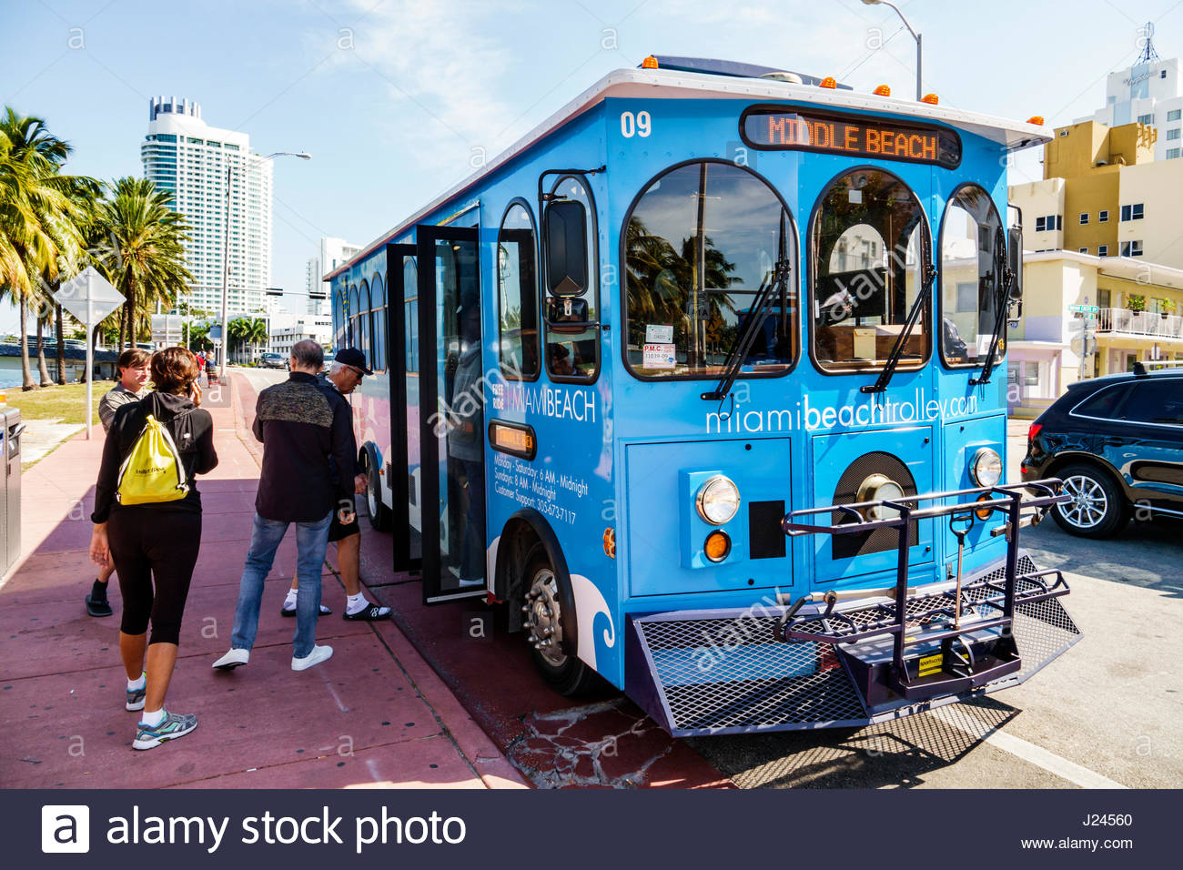 Miami Beach Florida Indian Creek Drive Middle Beach Loop Free Trolley Public Transportation Mass Transit Bus Stop Boarding Man Woman Passengers
