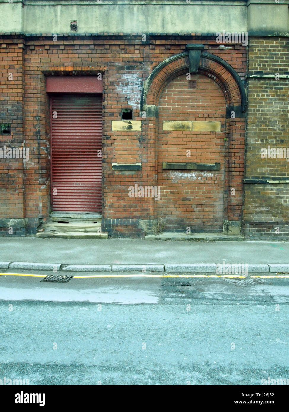 Stock Photo - old abandoned brick building with shutter and bricked up doorway and pavement & old abandoned brick building with shutter and bricked up doorway ... Pezcame.Com