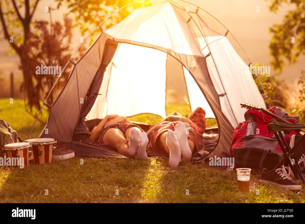 Couple sleeping in tent at early morning sun & Couple sleeping in tent at early morning sun Stock Photo ...