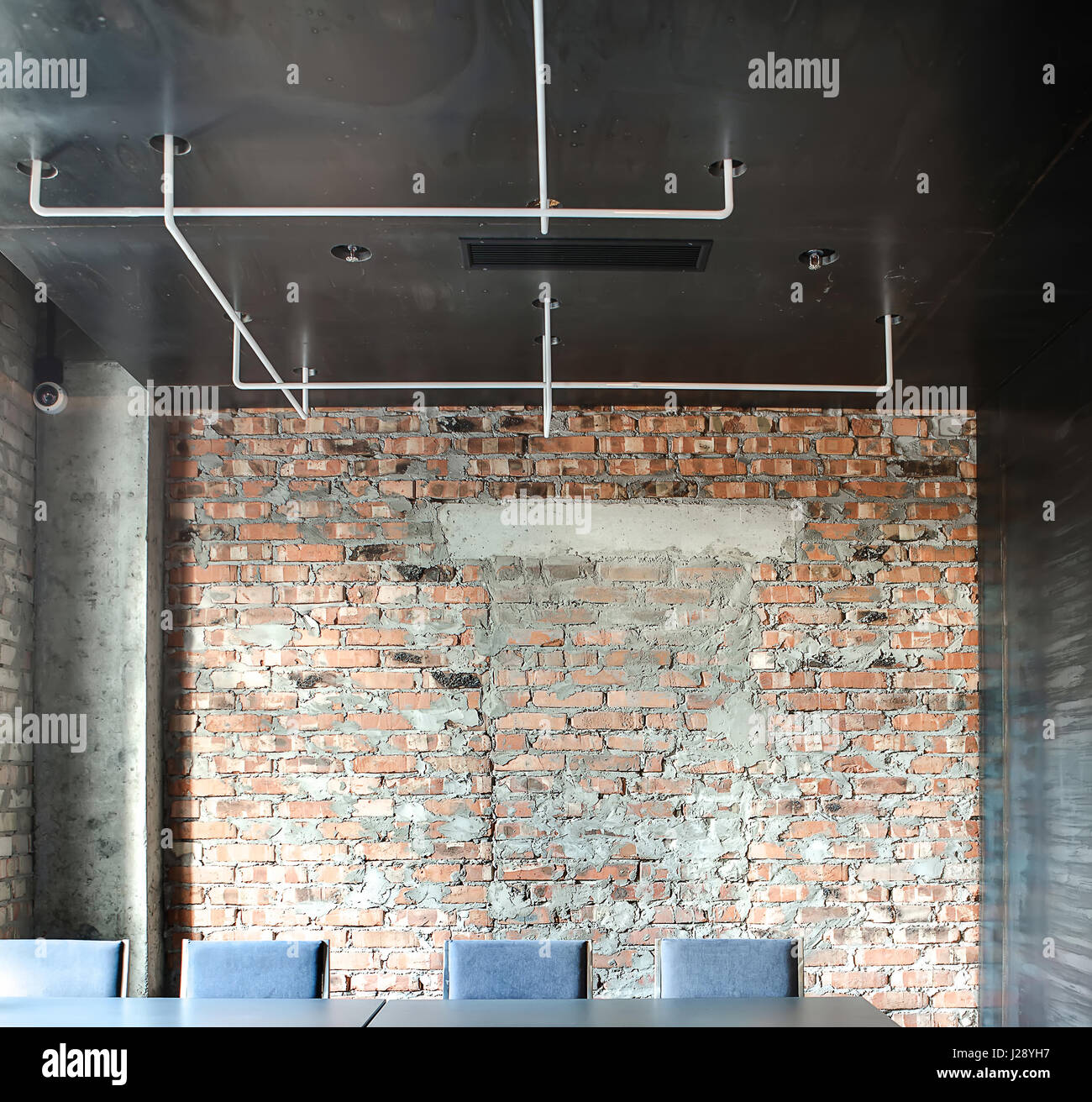 hall in a loft style in a cafe with brick walls and concrete