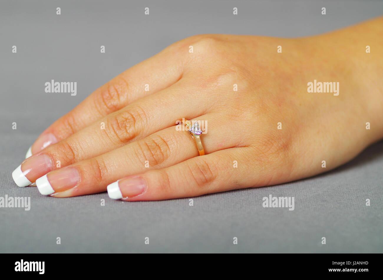 Close up shot of girl hand wearing ring Stock Photo, Royalty Free ...