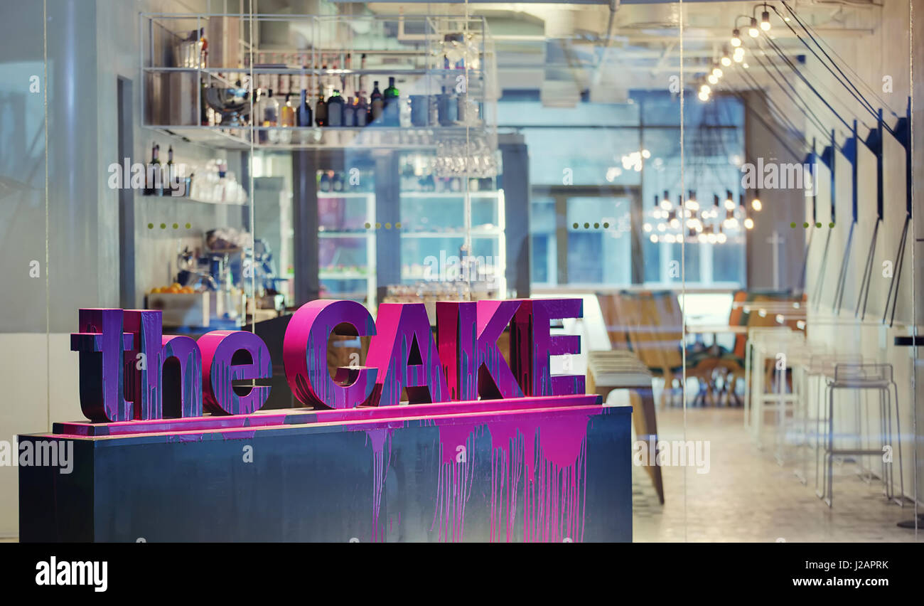 cafe in a modern style with a violet inscription the cake made of