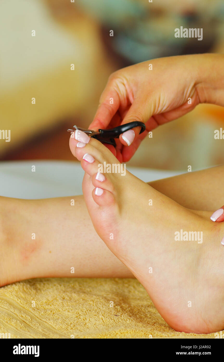 Close up Cutting cuticle on foot, nail scissors Stock Photo ...