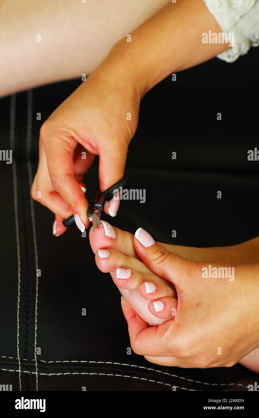 Close up Cutting cuticle on foot, nail scissors Stock Photo, Royalty ...
