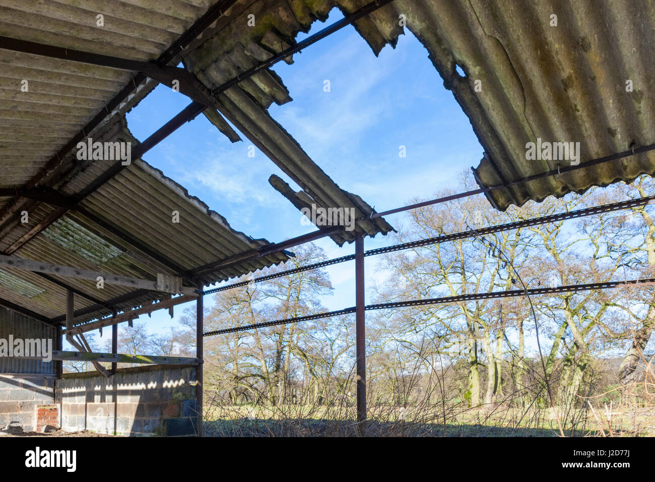 Damaged Asbestos Roof On An Old Farm Building Hathersage