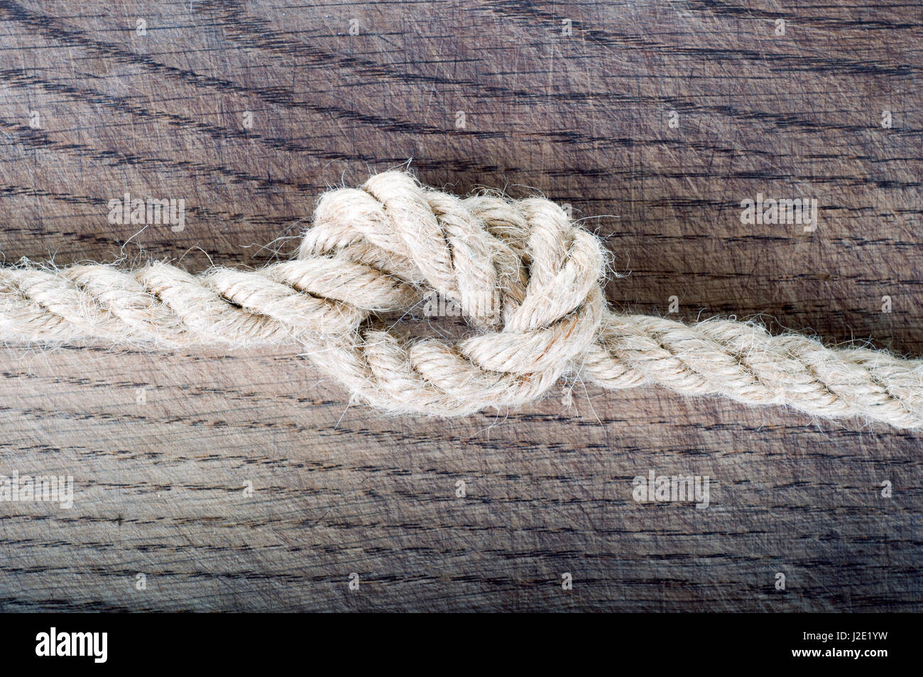 Rope knot as a strong nautical marine line tied together as a rope knot as a strong nautical marine line tied together as a symbol for trust and strenght biocorpaavc Choice Image
