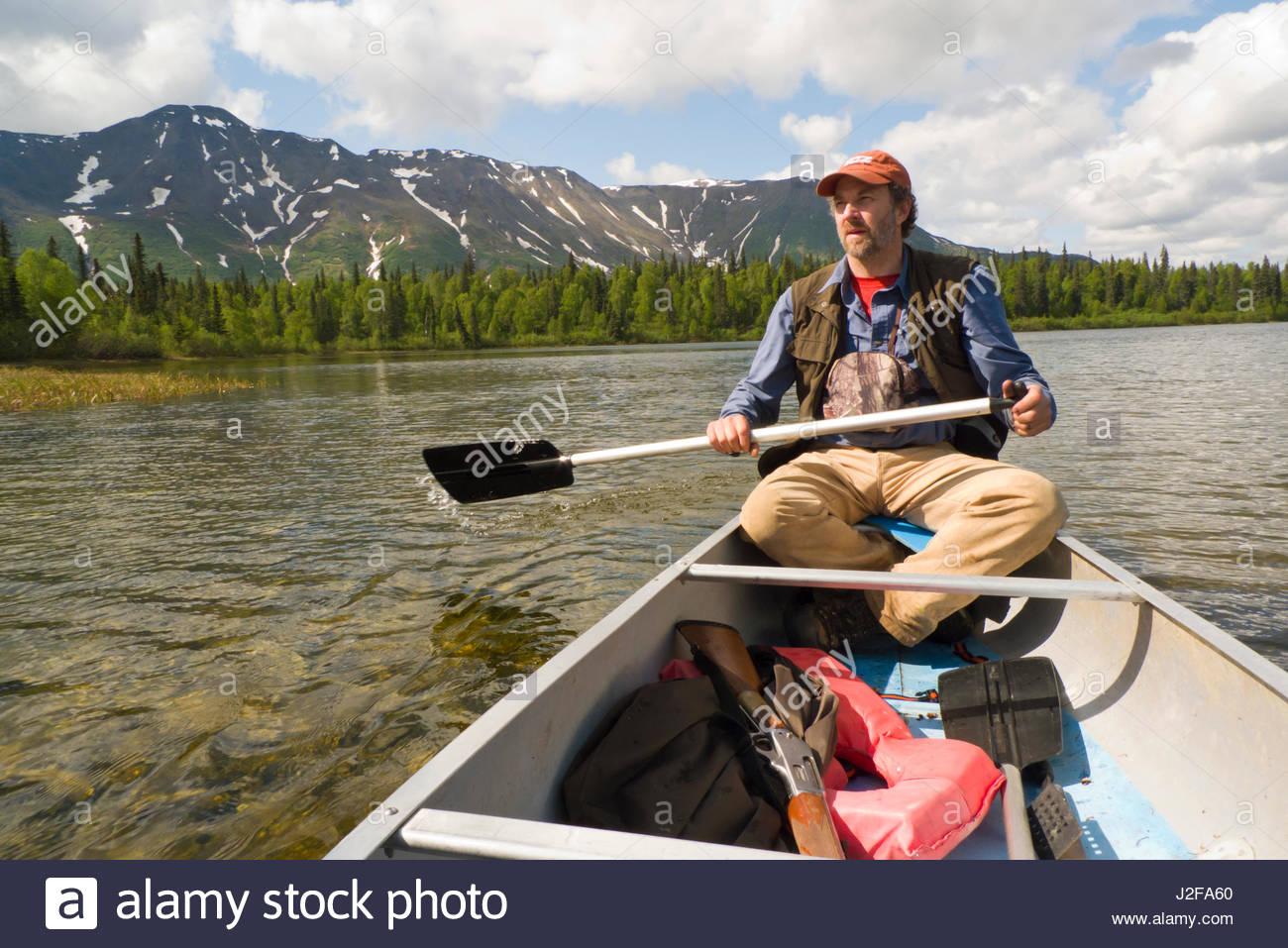 Alaska matanuska susitna county talkeetna - Mature Caucasian Man Paddling An Aluminum Canoe On Miami Lake Talkeetna Mountains Matanuska Susitna Borough Alaska Usa