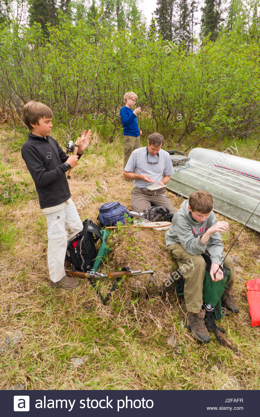 Alaska matanuska susitna county talkeetna - Mature Caucasian Man Helping Three Teenage Boys Get Ready To Go Fishing Miami Lake Talkeetna Mountains Matanuska Susitna Borough Alaska Usa