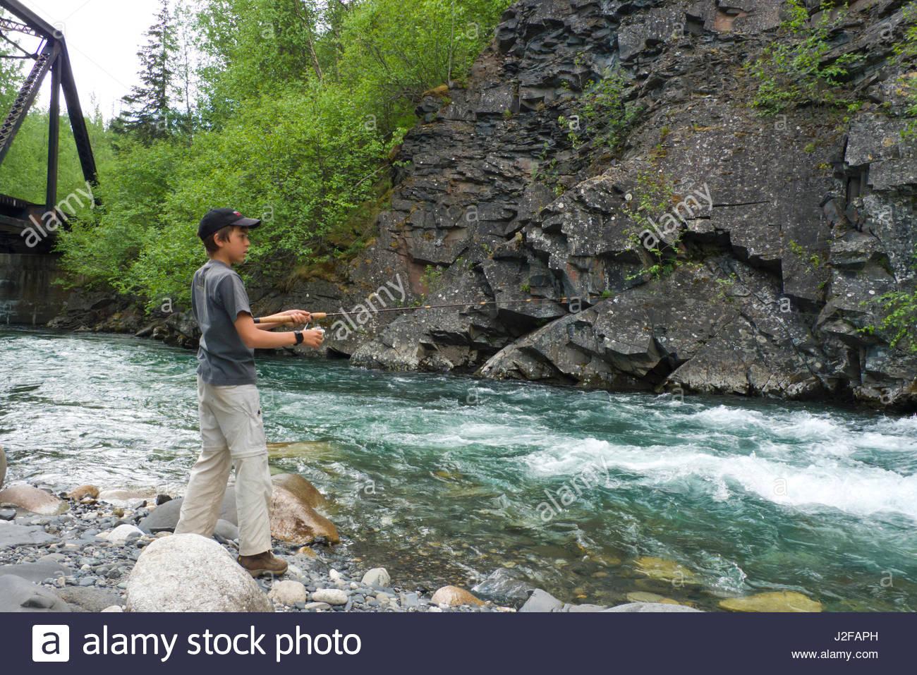 Alaska matanuska susitna county talkeetna - Stock Photo Young Teenage Boy Fishing In The Swift Flowing Indian River Talkeetna Mountains Matanuska Susitna Borough Alaska Usa