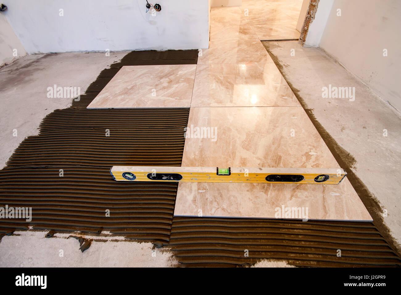 Ceramic tiles and tools for tiler floor tiles installation home ceramic tiles and tools for tiler floor tiles installation home improvement renovation ceramic tile floor adhesive mortar level doublecrazyfo Gallery