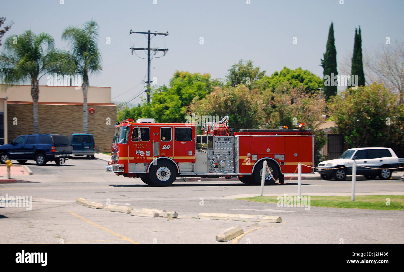 Los angeles county fire truck traveling through the streets of los angeles stock image