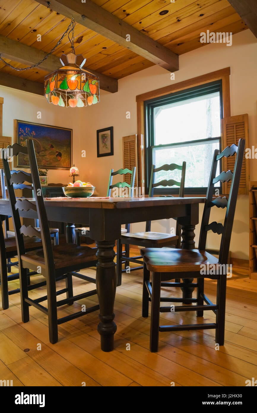 Dining Room With Antique Style Wooden Table And High Back Chairs Inside A Canadiana Cottage Log Home Quebec Canada