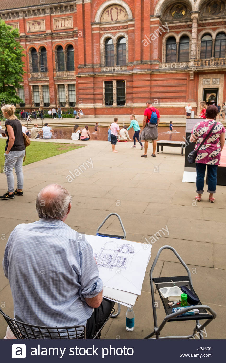 Man sitting in chair drawing - Man Sitting In Chair Drawing Facade Of Building In Central Garden At The Victoria And Albert Museum South Kensington London England United Kingdom