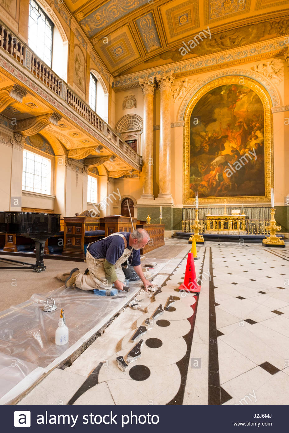Man on knees working on ornate floor tiles inside the chapel of st man on knees working on ornate floor tiles inside the chapel of st peter and st paul at the old royal naval college greenwich london england unite dailygadgetfo Images