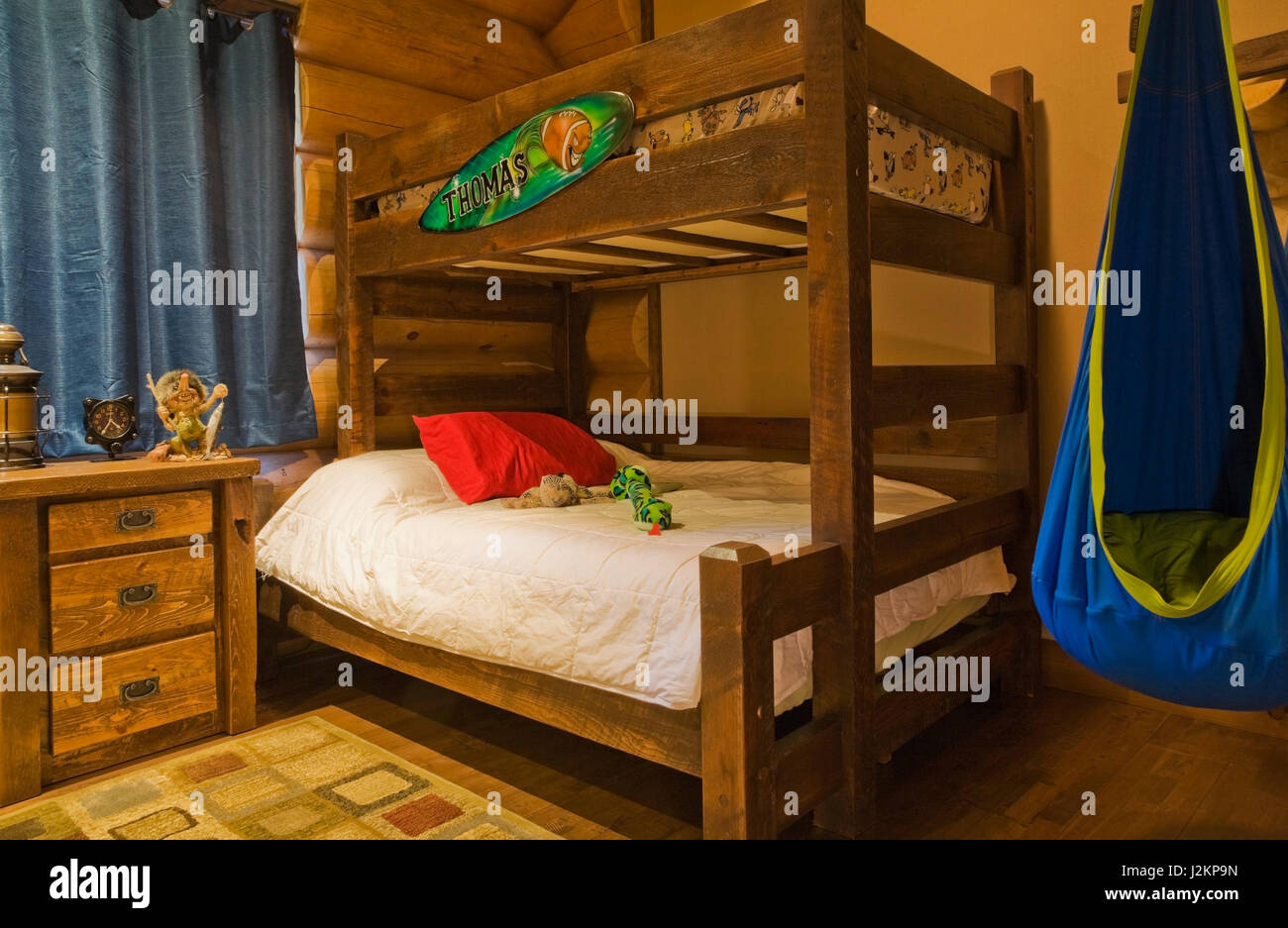 old wooden bunk bed and blue and green hammock chair in boys bedroom on ground floor inside a luxurious scandinavian log and timber cottage style home old wooden bunk bed and blue and green hammock chair in boys      rh   alamy