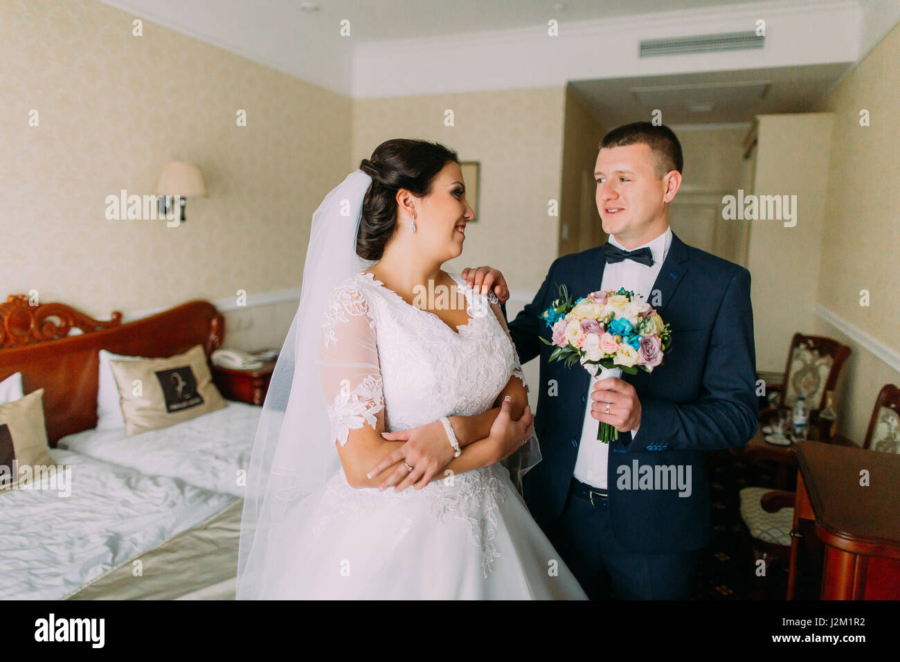 Newlyweds Posing In Hotel Room After Wedding Ceremony Honeymoon Concept