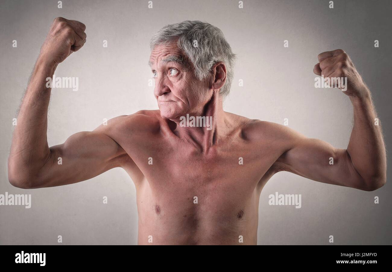 Old man flexing his muscles Stock Photo: 139363825 - Alamy