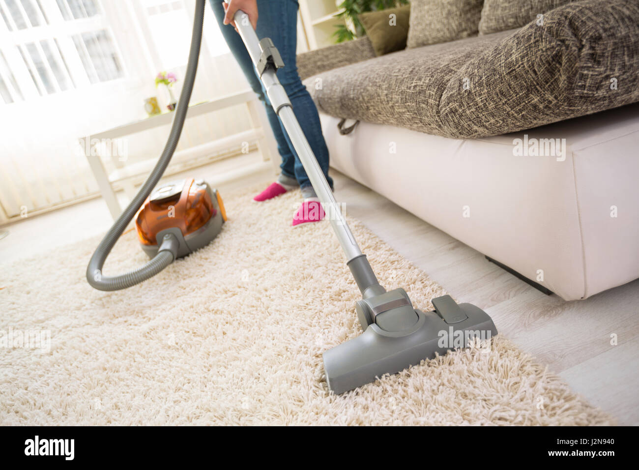 Cleaning Carpet With Vacuum Cleaner In Living Room Stock