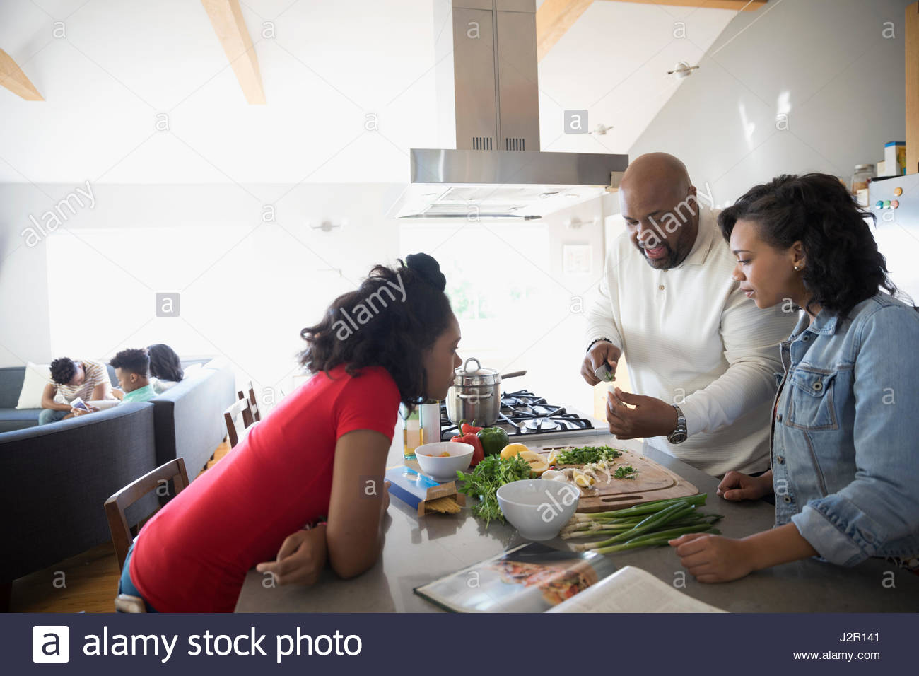 Family cooking kitchen - African American Family Cooking In Kitchen
