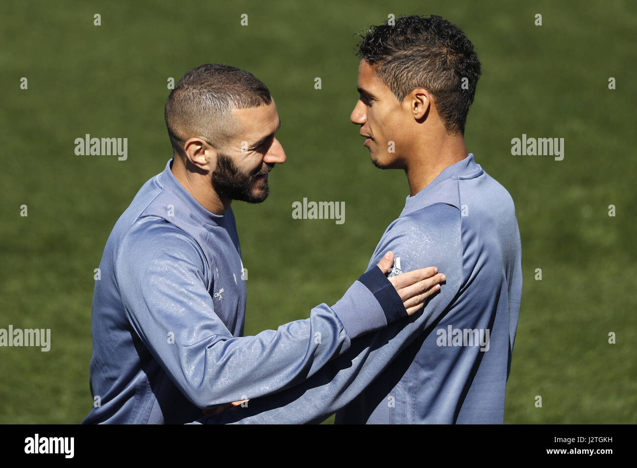 Real Madrid s French forward Karim Benzema L talks to defender