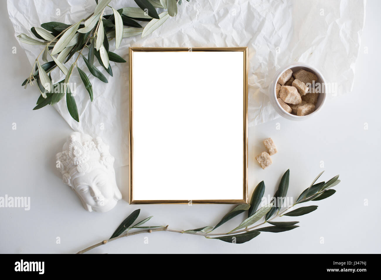 white table top background. golden frame mock-up on white tabletop background, home decor flatlay with plants and objects table top background g