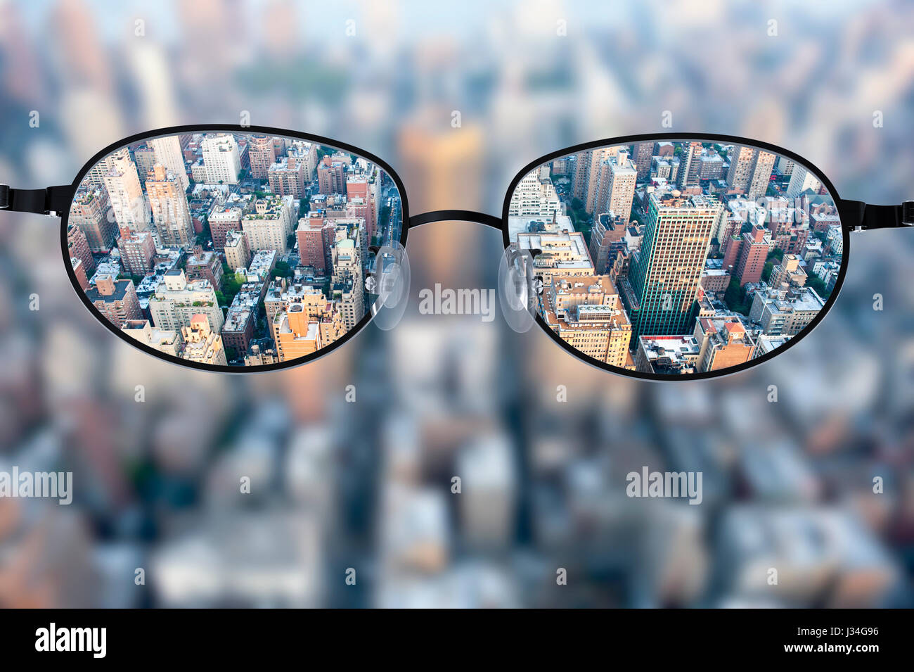 Clear Cityscape Focused In Glasses Lenses With Blurred