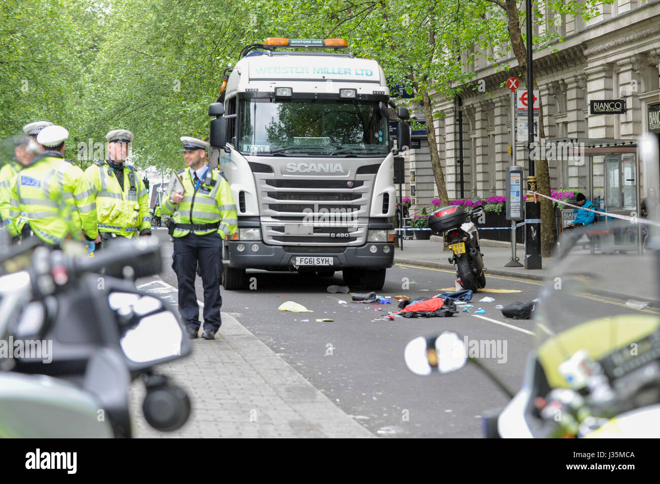 Police and emergency services attend the scene of a reported traffic accident between a lorry and a motorbike which has taken place in northumberland avenue