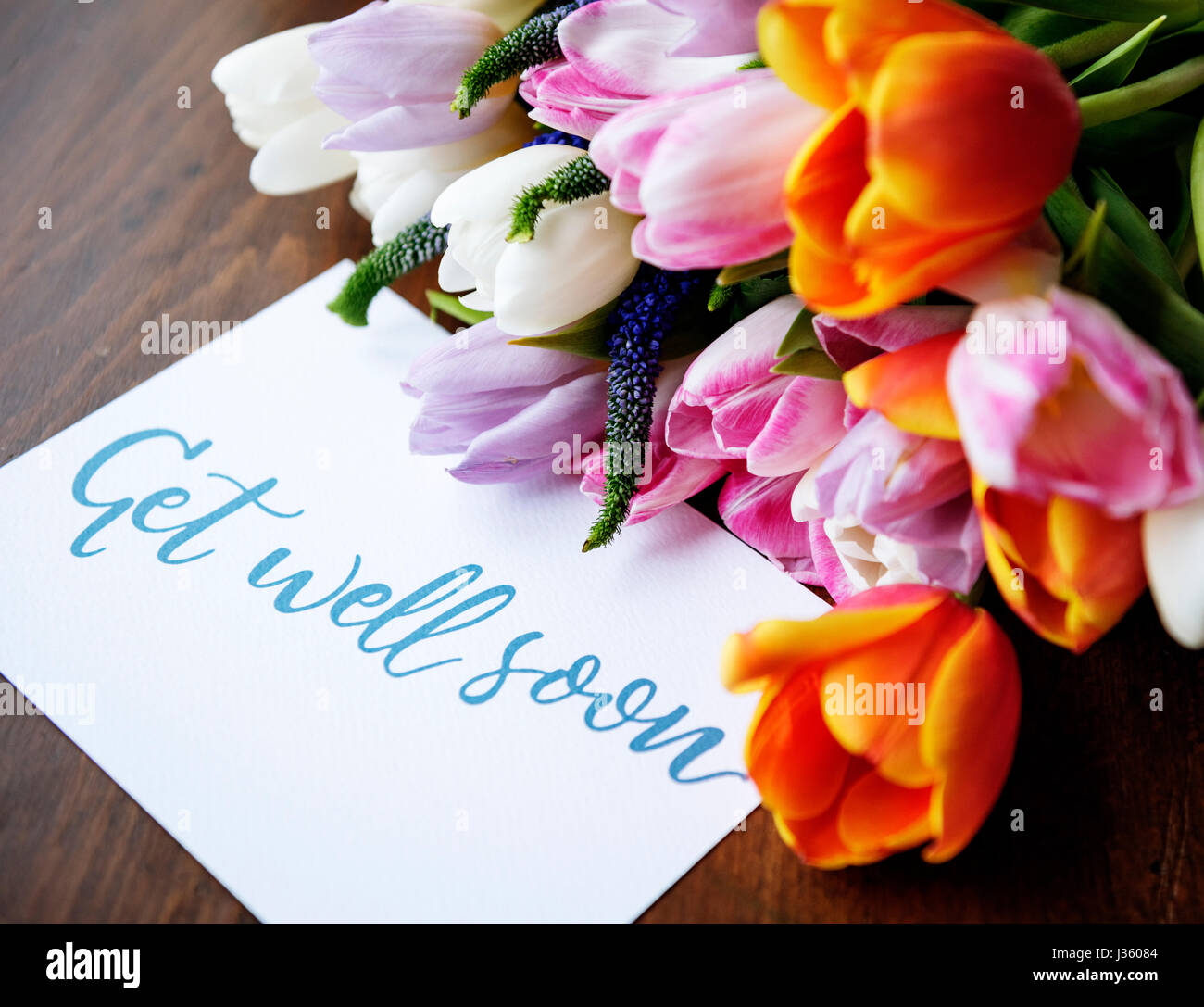 Tulips flowers bouquet with get well soon wishing card stock photo stock photo tulips flowers bouquet with get well soon wishing card dhlflorist Images