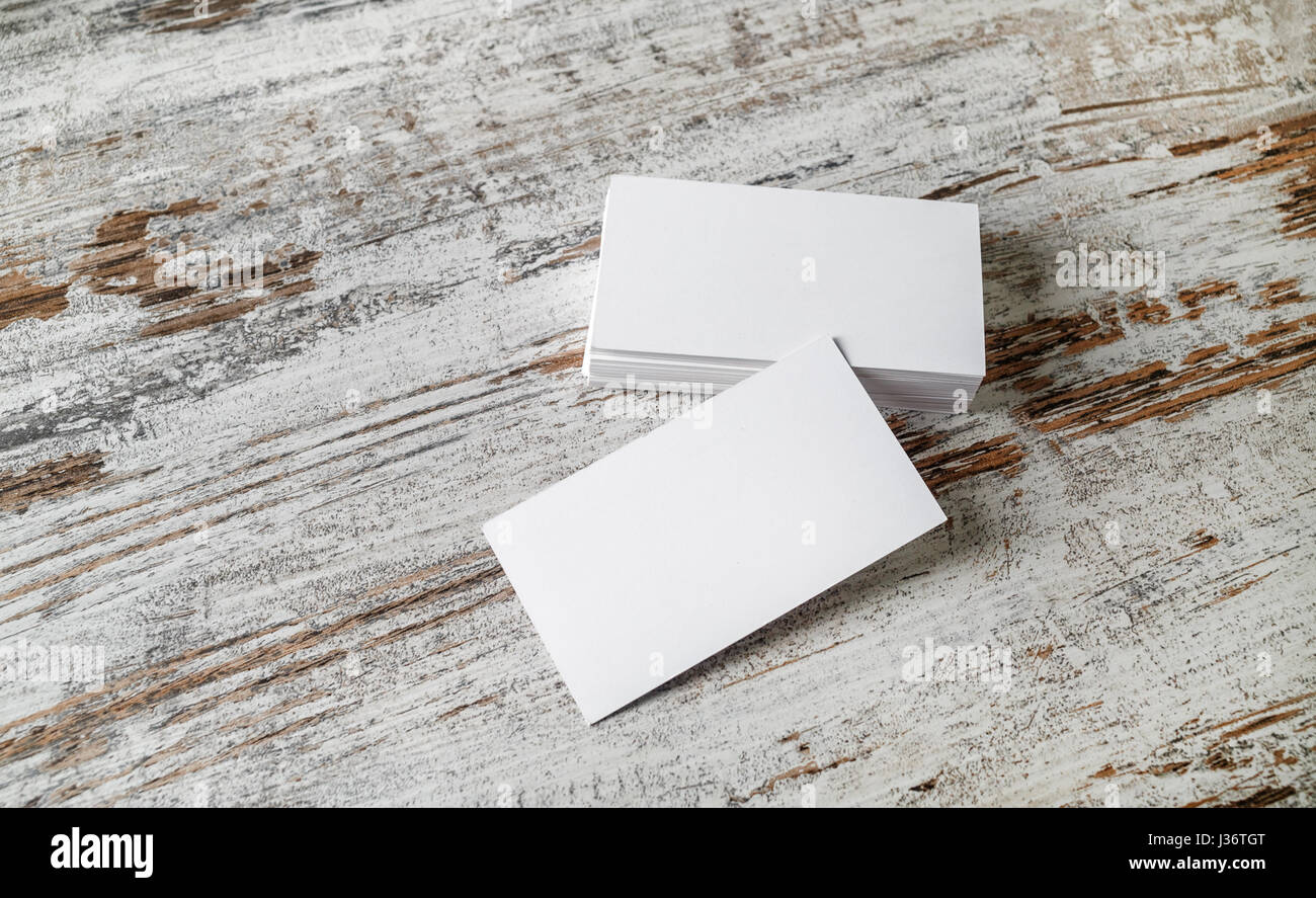 Photo of blank business cards on old wooden table background Stock ...