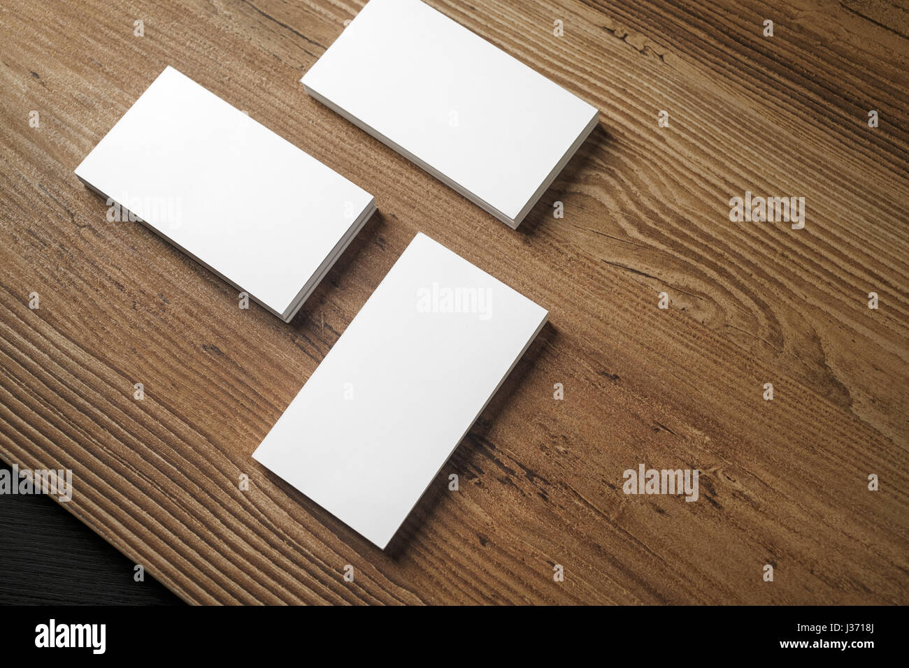 Piles of blank business cards on wood table background blank piles of blank business cards on wood table background blank stationery mock up for reheart Images