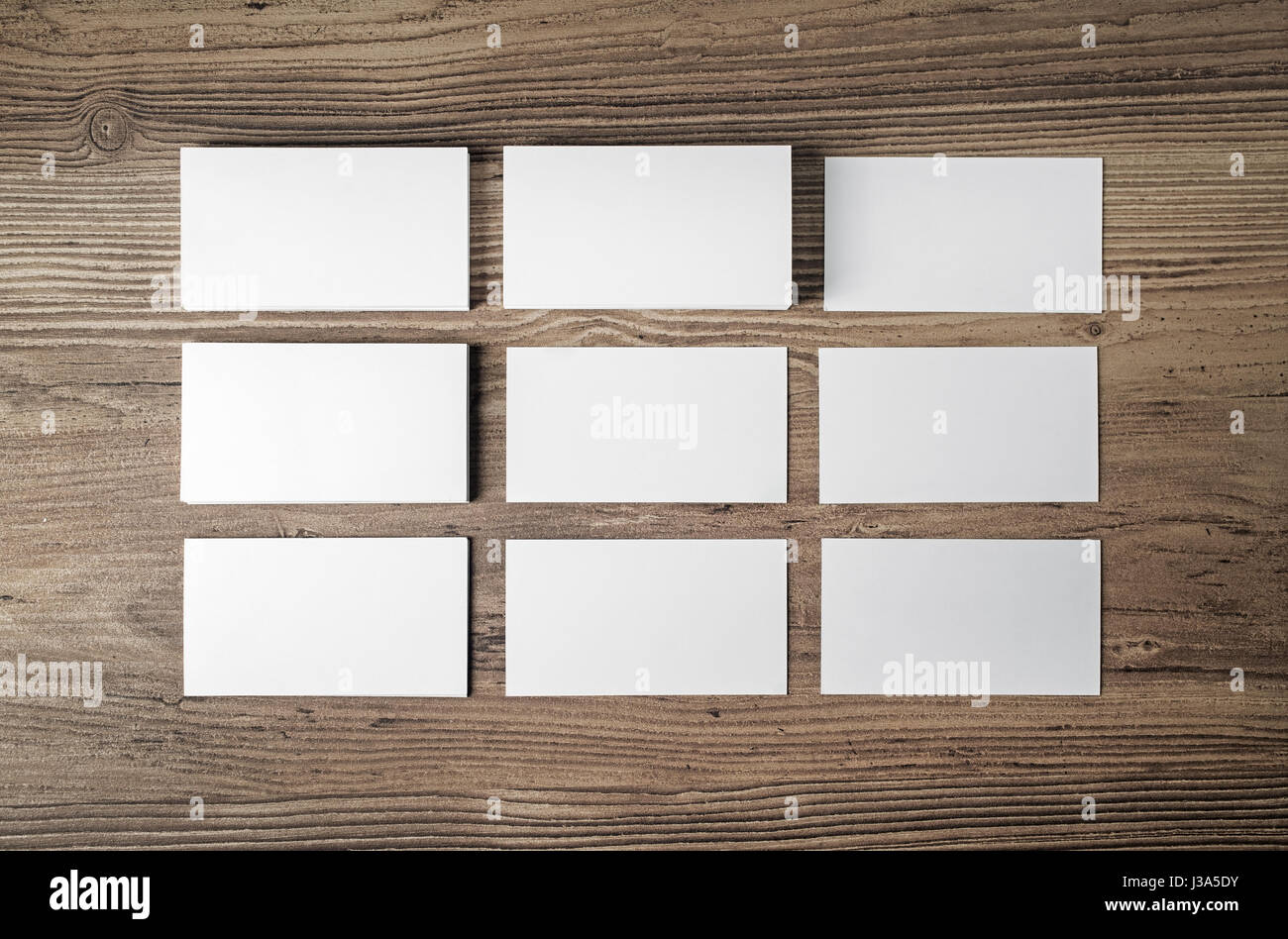 Many blank business cards on wood table background. Blank ...