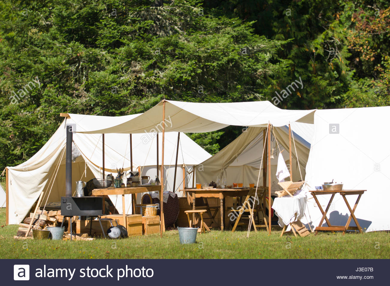 White canvas tents and awning with wood c& furniture and supplies at Civil War Reenactment Milo McIver State Park Estacada Clackamas County Oreg & White canvas tents and awning with wood camp furniture and ...