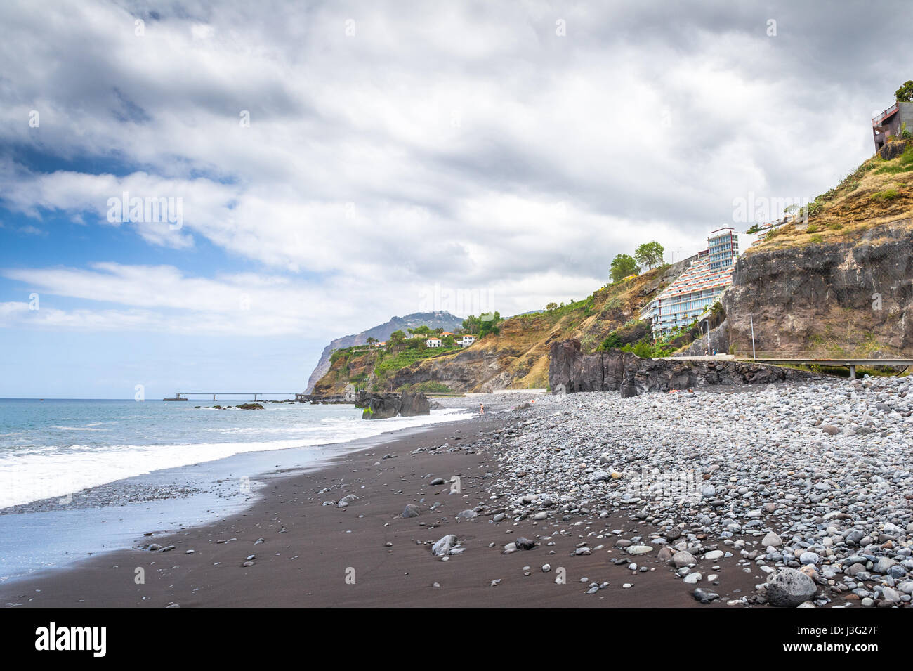 Rocky And Dark Sandy Beach At Funchal On The South Coast Of Madeira