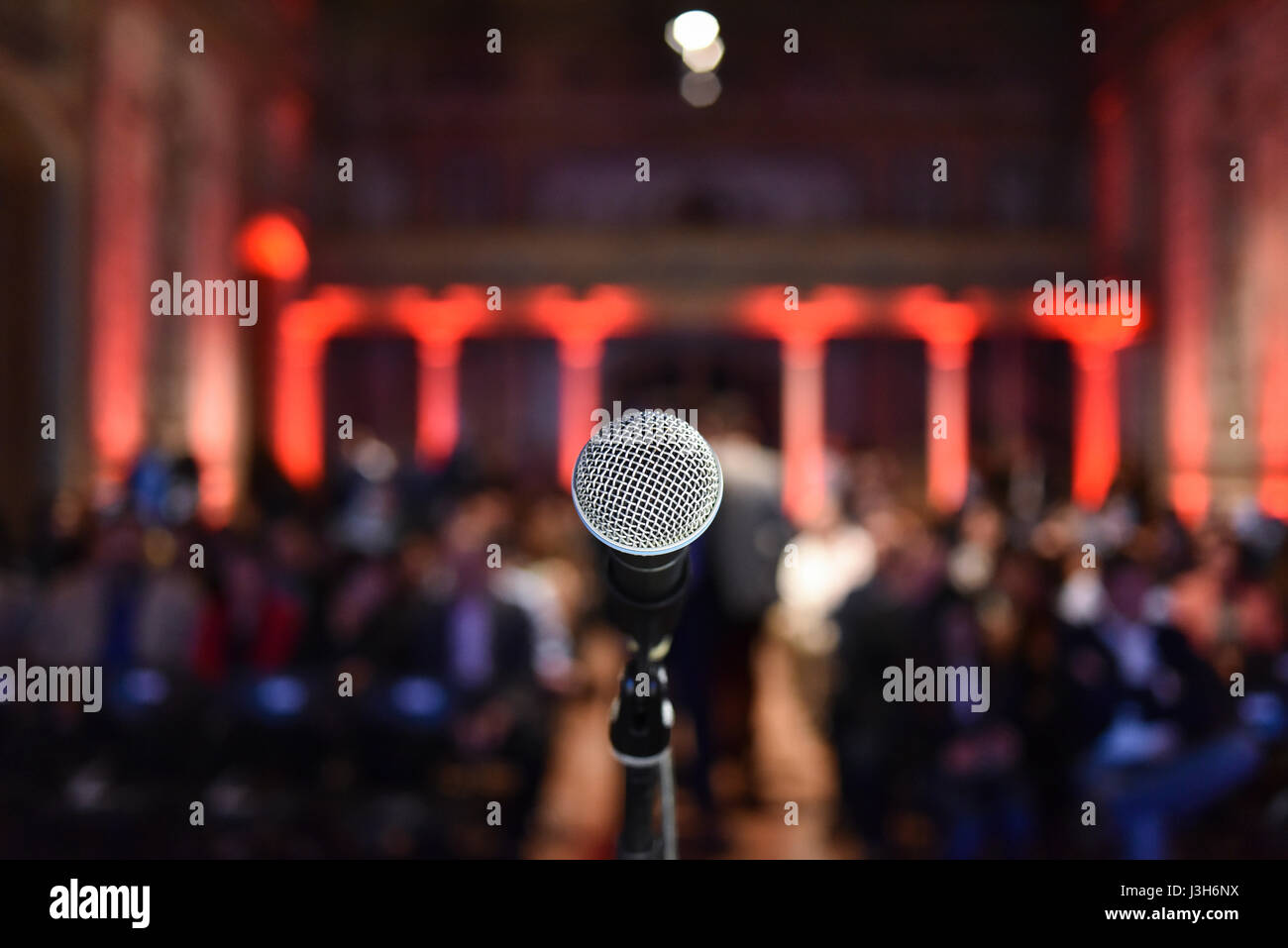 Stock photo dramatic red old fashioned elegant theater stage stock - Lone Microphone Mic On Stage Facing Blurred Audience In Art Deco Theatre Stock Image