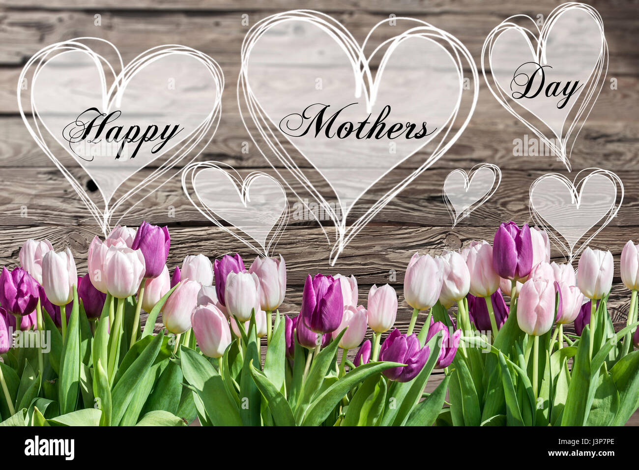 Happy mothers day text heart with pink and white tulips on rustic happy mothers day text heart with pink and white tulips on rustic wooden background greeting card spring flowers kristyandbryce Choice Image
