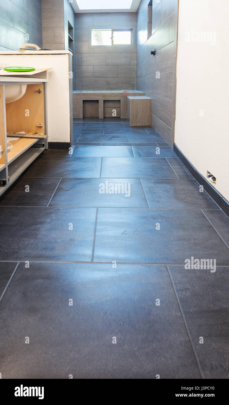Floor and wall tile in residential bathroom installed Stock Photo ...