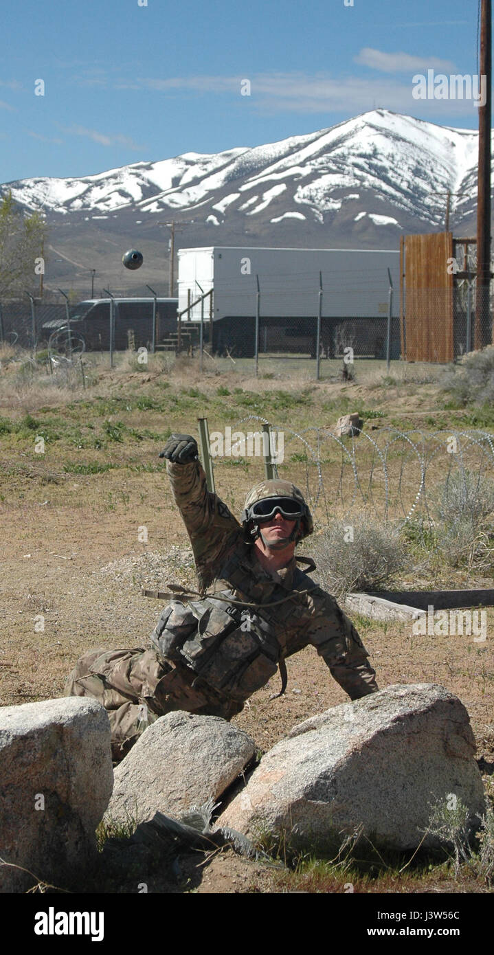 Sgt. Justin Sample of the 137th Military Police Company fires a ...