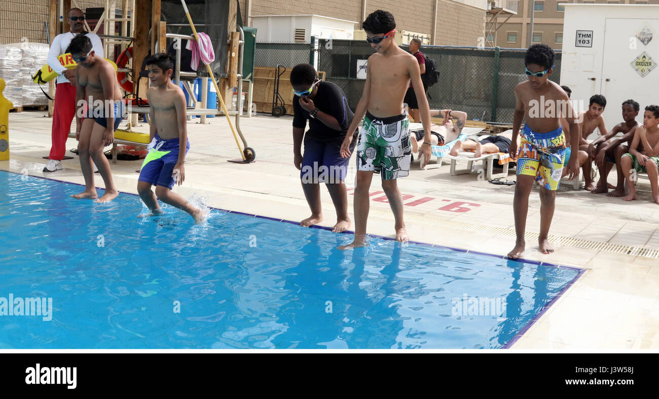 Boy Scouts of Troop 965 Kuwait jump feet first into the swimming ...