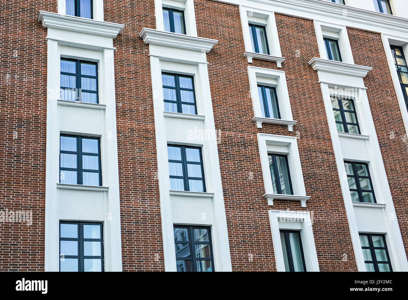 stock photo the facade of the house or hotel the windows and decoration of walls - Brick Hotel Decoration