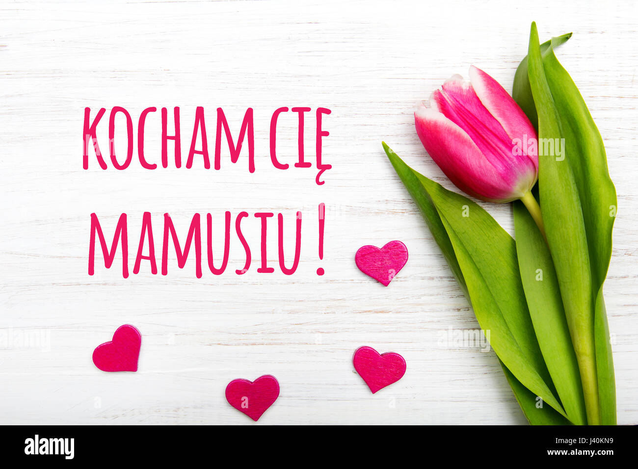 Mothers day card with polish words i love you mom pink tulip on mothers day card with polish words i love you mom pink tulip on white wooden background kristyandbryce Choice Image
