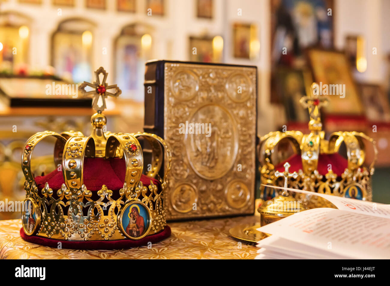Two Crowns Next To The Bible For A Wedding Ceremony Close Up