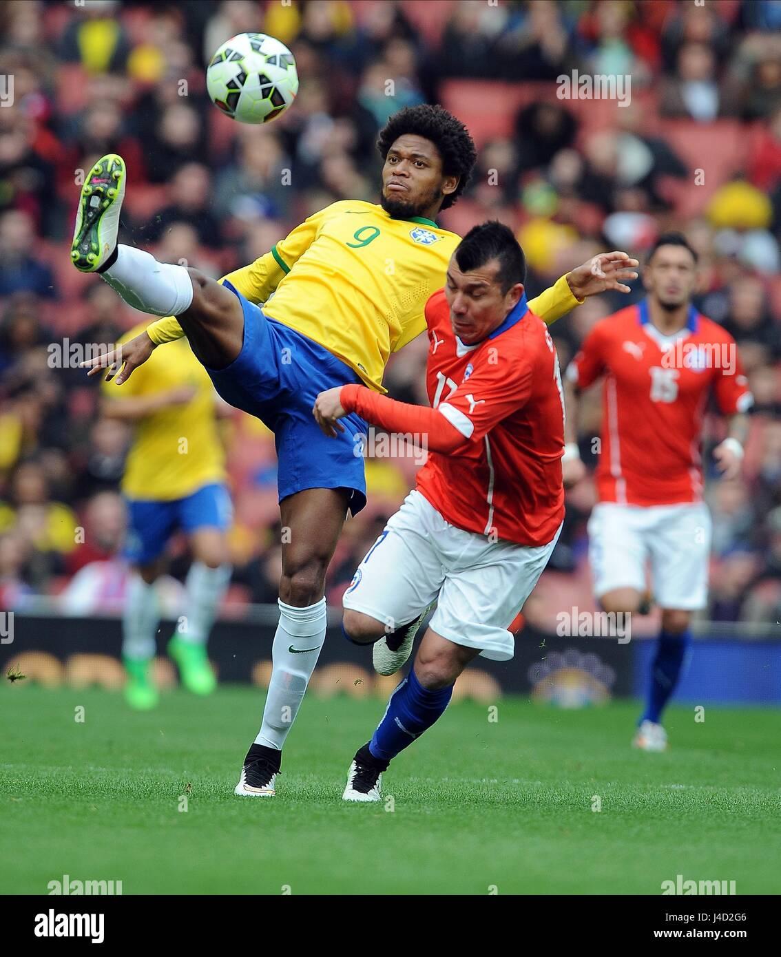 LUIZ ADRIANO OF BRAZIL IS CHAL BRAZIL V CHILE EMIRATES STADIUM