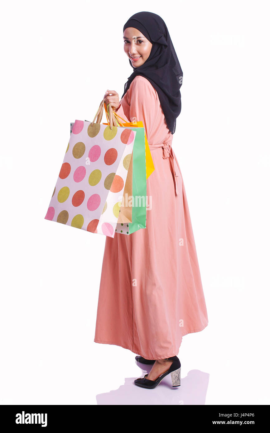 Woman posing with shopping bags isolated on white background full - Stock Photo Woman Wear A Dress Hold Shopping Bag Enjoy Buying Items Isolated On White Background Shopping Consumer And Lifestyle Concept