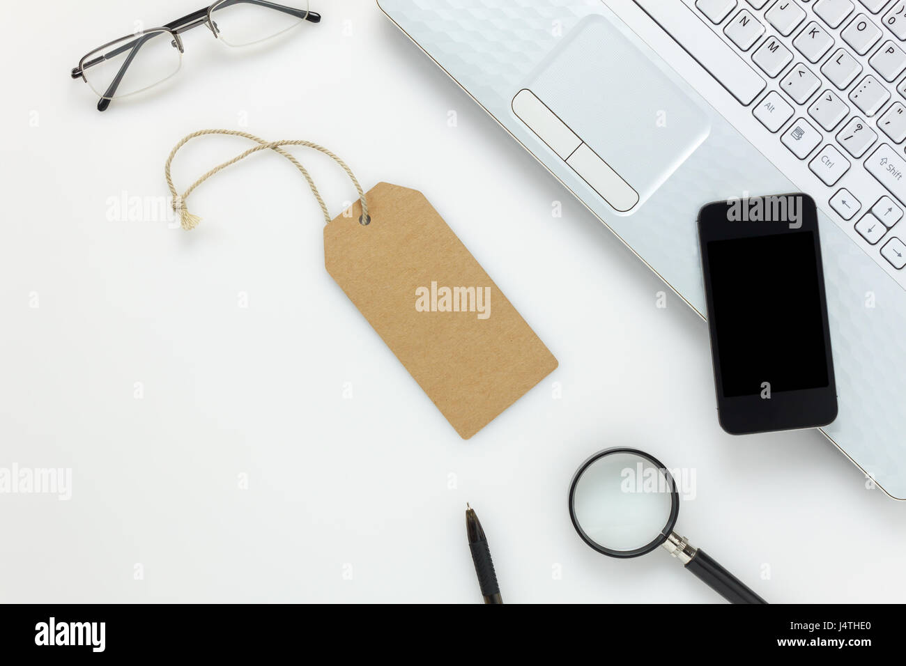 Top view accessories business office deskbile stock photo top view accessories business office deskbile phonelaptopgreeting cardeyeglassesmagnifier on white office desk with copy space kristyandbryce Gallery